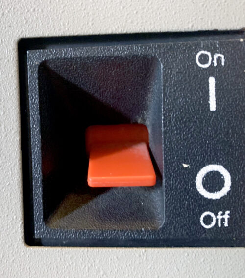 You flip the big red switch (BRS) on the side to power the PC 5150 up or down