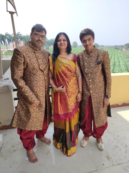 Toshan, an Indian teenager, with his mother and father.